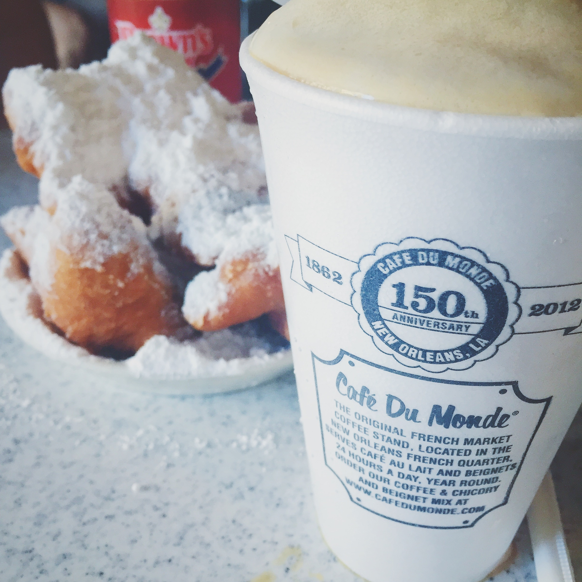 Half a dozen beignets and cafe au lait from Cafe Du Monde, New Orleans, La